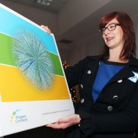 Niagara Connects chair Dr. Madelyn Law looks over the network map created last December of the group's more than 1,500 links to other organizations in the community.